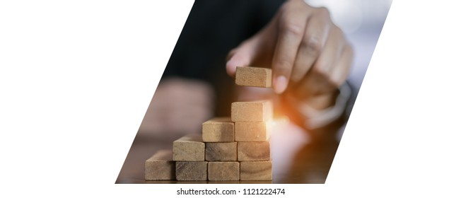 Businessman planing and strategy putting wooden blocks risk or success project stack of hands playing challenge game building construction protect at office of panoramic copy space web banner.