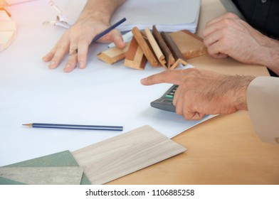 Businessman planning with Architect and Engineer to choose material in new project. cooperation for construction. Corporate Achievement Planning Design Draw Business. Brainstorming Group of people