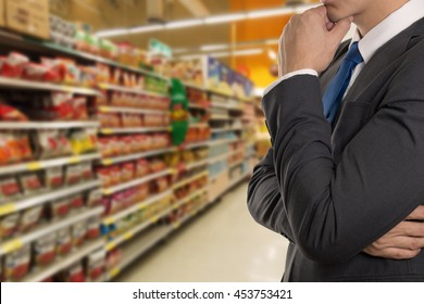 Businessman planning on retail product in department store blur background