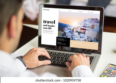 businessman planning a travel with a laptop, All screen graphics are made up.
