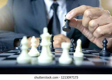 Businessman play chess how  to crash overthrow the competitor concept business strategy for win