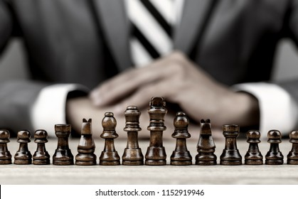 Businessman playing chess board game for development analysis new strategy planning.The battle of competition and strategy ideas with market mechanism.