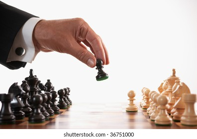 businessman playing chess game selective focus back makes first move