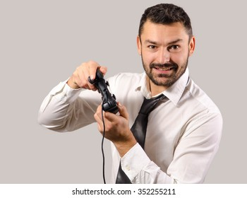 Businessman playing with controller