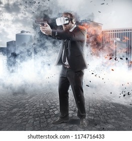 Businessman is playing a game wearing virtual reality glasses and holding a gun