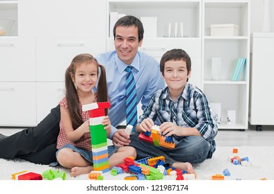Businessman playing with his children after the working time