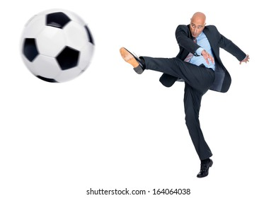 Businessman playing soccer ball isolated in white