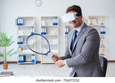 Businessman playing virtual reality tennis in office with VR gog