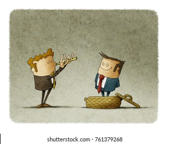 businessman plays a flute like a snake charmer, another business man comes out of the basket. concept of manipulation of people
