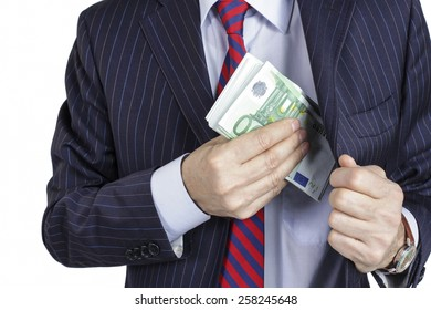 Businessman pocketing a bribe