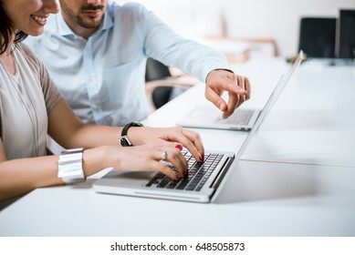 Businessman pointed a finger at notebook, boss pointing on funny post on the computer.