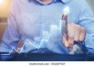 Businessman pointing arrow graph growing corporate on world map background. Development  to success and growing growth international  business.