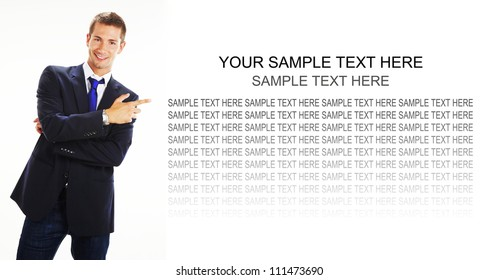 Businessman pointing at blank panel against a white background