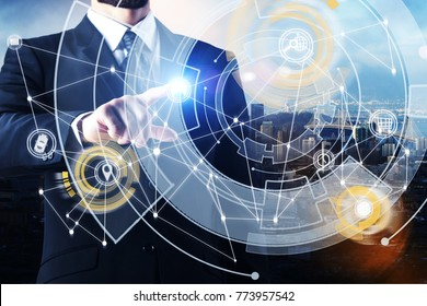 Businessman pointing at creative digital business interface on city background. Future and hud concept. Double exposure