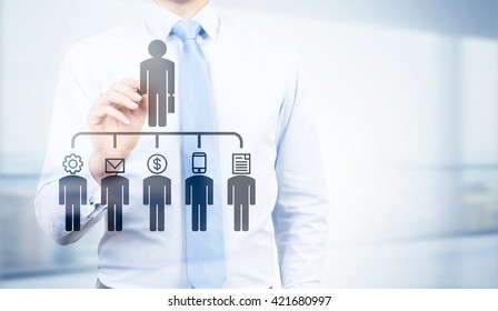 Businessman pointing at delegating pictogram on bright background