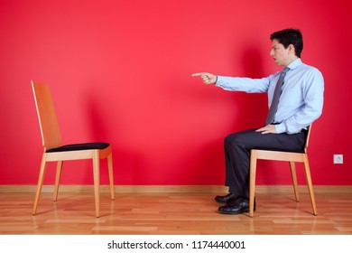 Businessman pointing to an empty place