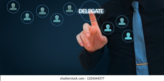 Businessman pointing finger to delegate word on virtual screen - Manager delegate work on another person in team. Managerial concept with delegation.