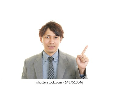 Businessman pointing with his finger.