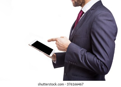 Businessman pointing to his tablet computer, isolated on white background