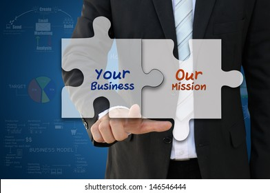 Businessman pointing jigsaw for business mission concept