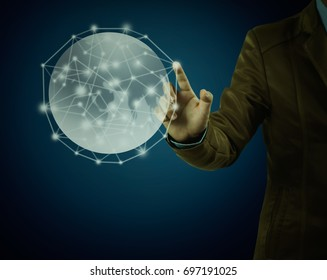 Businessman pointing on globe on blue background, concept as social connection