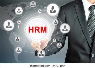 Businessman pointing on HRM (Human Resource Management ) sign on virtual screen with people icons linked as network