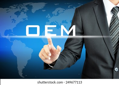 Businessman pointing on OEM (Original Equipment Manufacturer) sign on virtual screen