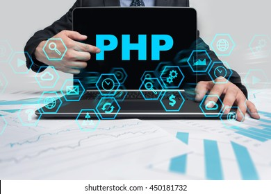 Businessman is pointing on virtual screen and selecting PHP.