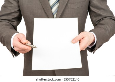 Businessman pointing with pen at blank paper on isolated white background