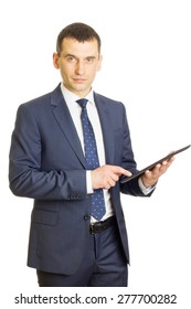 Businessman pointing in tablet computer and looking at camera