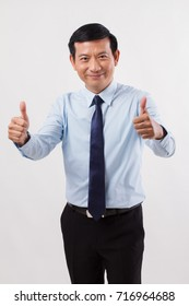 businessman pointing up thumb up gesture