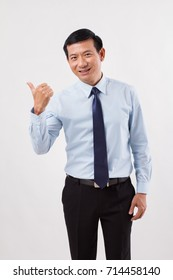businessman pointing up thumb up to his side