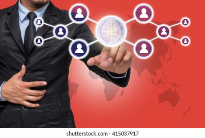 Businessman pointing or touching the Social media symbol on red color background with world map, Elements of this image furnished by NASA, Business network concept