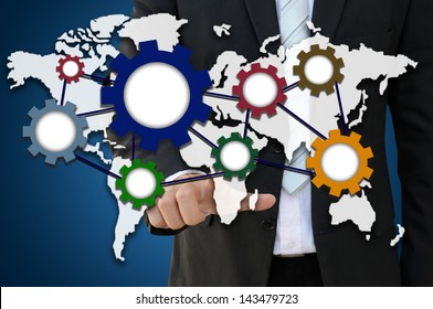 Businessman pointing world map with dynamic gear for international business cooperation