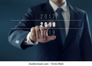 Businessman pointing year 2018. Business new year card concept.