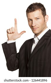 Businessman Points Up to Blank Copy Space on white background