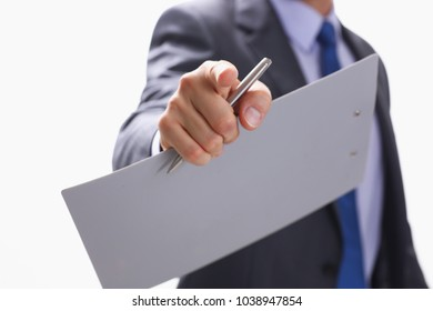 Businessman points a finger at someone who