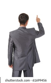 Businessman points finger up. Isolated on white background