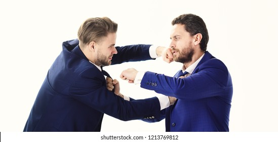 Businessman and politician fighting. Conflict of interest, business conflict, business fight. Men wearing suits and boxing. Aggression, competition, politics concept. Liberal against conservative.