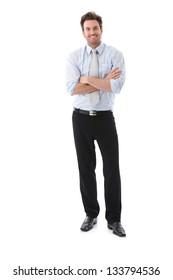 Businessman Portrait.  Confident businessman standing arms crossed, smiling.