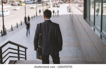 Businessman portrait. View from back.