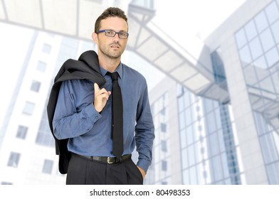 Businessman posing in a business center