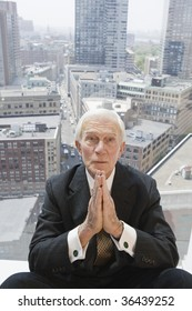 Businessman praying to meet the numbers.