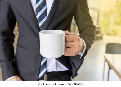 Businessman prepare coffee for the meeting.