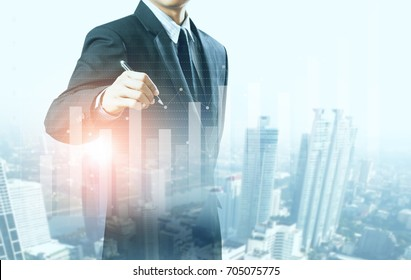 businessman present increasing graph with city background, business growth