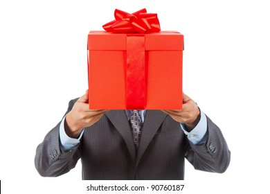Businessman present red gift box with ribbon bow, isolated over white background.