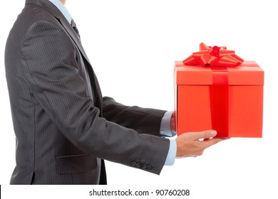 Businessman present red gift box with ribbon bow, side view, isolated over white background.