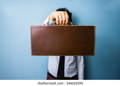 Businessman presenting a briefcase of importance