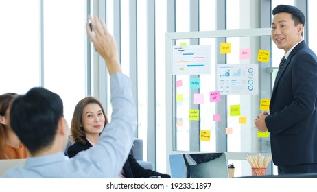 Businessman presenting business plan information to team at office meeting, Asian leader man explaning business chart for teamwork, business people, success in business concept
