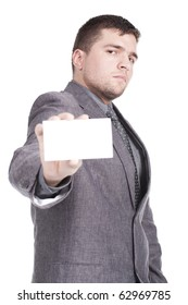 Businessman presenting card isolated on white